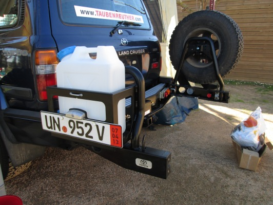 ARB rear bumper system. Steel with jerry can holder and spare tire mounts that swing away from the back of the truck