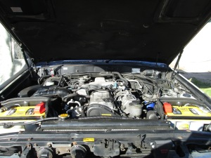 !HD-FT 4.2L Turbo Diesel Engine with IBS Dual Battery Relay and Optima Yellow-Top batteries. The starter is 24v and there is a third battery in the truck for accessories.