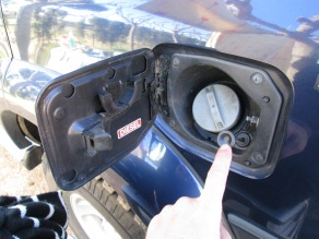 This valve manually controls which tank is being filled: in for the main fuel tank, and out for the auxiliary tank.