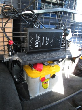 The third Optima Yellow Top battery which runs our refrigerator, the exterior lighting from ELS, and our winch. Also pictured is the IBS 300w inverter which allows us to charge electrical items with a normal plug. It is limited to 300w of items, and also draws heavily on the battery when it is turned on.