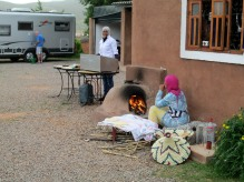 The ladies of Zebra Camp preparing bread.