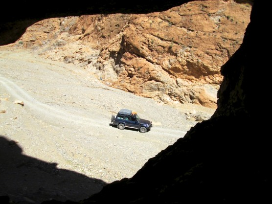 A view of the truck from a cave we came across while taking a shortcut through the mountains.